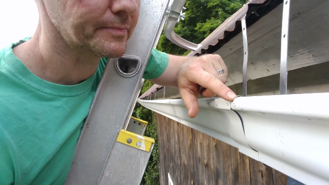 Lessons Learned Installing Cheap Gutters New Hampshire Man